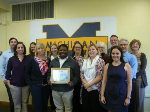 Dean of Students staff posing with platinum award
