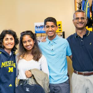 Parents and student in campus book store.