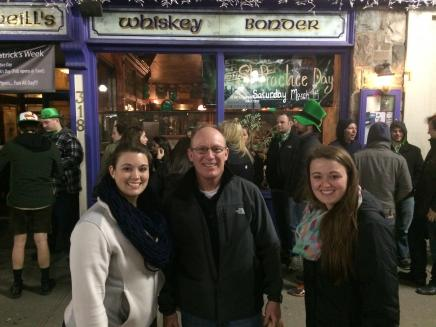Students and staff passing out bagels in front of Connor O'Neill's on St. Patrick's Day 2015.